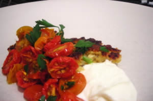 Corn fritters with slow-roasted tomatoes and fromage blanc